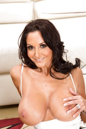 Luscious brunette MILF with massive melons slowly taking off her clothes