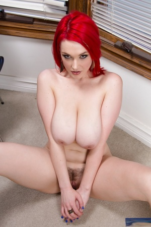 Frisky redhead sweetie revealing her amazingly big melons and trimmed slit