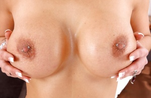 Smiley vixen with pierced nipples and clit undressing and exposing her goods